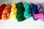 a rainbow of yarn on a table